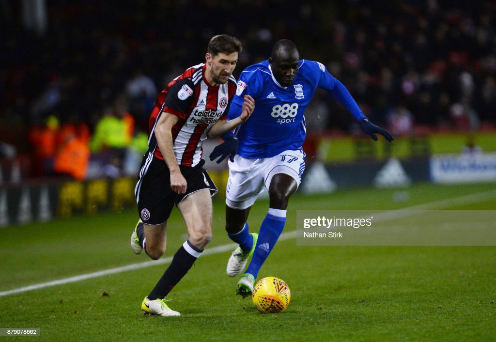 Chris Basham of Sheffield United and Cheikh Ndoye of Birmingham City in action during the Sky Bet Championship match between Sheffield United and Birmingham City at Bramall Lane on November 25, 2017 in Sheffield, England.