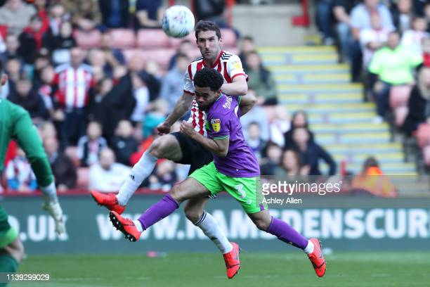 Chris Basham of Sheffield United crosses the ball as Jay DaSilva of Bristol City challenges during the Sky Bet Championship match between Sheffield...