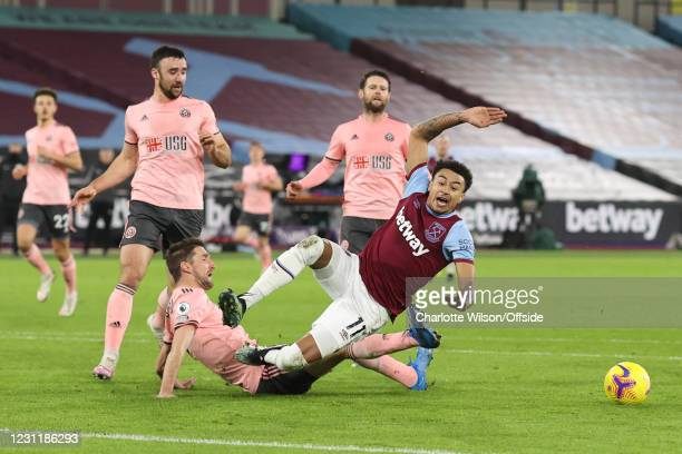 Chris Basham of Sheffield United fouls Jesse Lingard of West Ham United to give away a penalty during the Premier League match between West Ham...