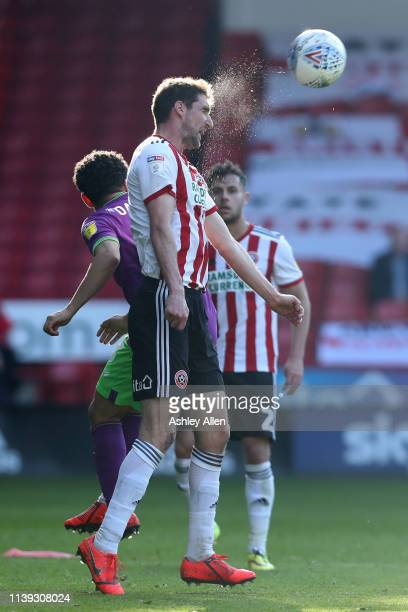 Chris Basham of Sheffield United heads the ball during the Sky Bet Championship match between Sheffield United and Bristol City at Bramall Lane on...