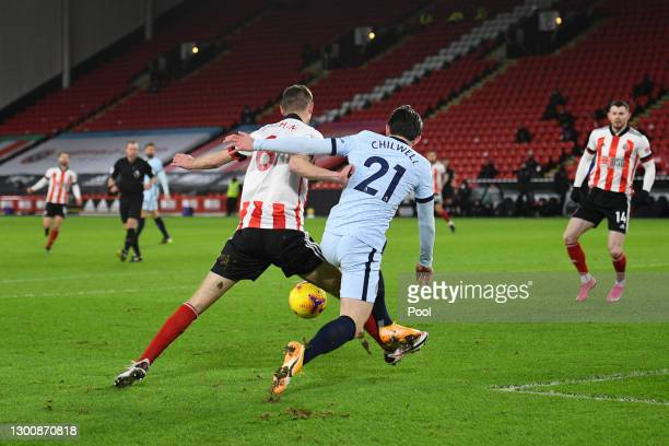 Chris Basham of Sheffield United is fouled by Ben Chilwell of Chelsea during the Premier League match between Sheffield United and Chelsea at Bramall...