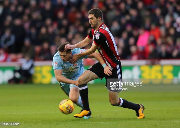 Chris Bashham of Sheffield United gets the better of Lynden Gooch of Sunderland during the Sky Bet Championship match between Sheffield United and...