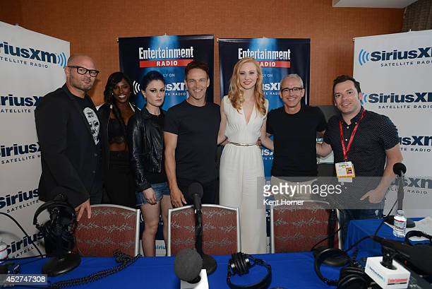 Chris Bauer Rutina Wesley Anna Paquin Stephen Moyer Deborah Ann Woll pose with radio hosts Jess Cagle and Tim Stack after being interviewed on...