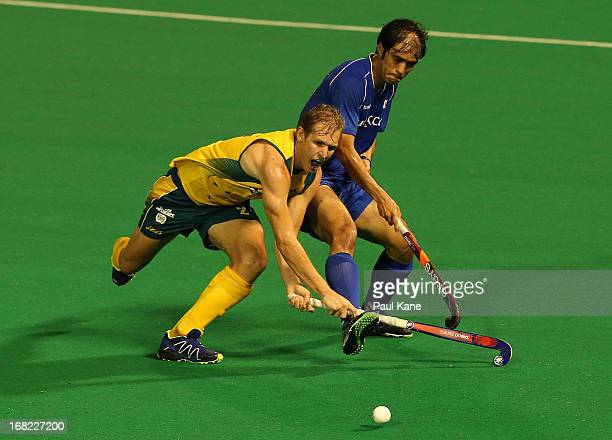 Chris Bausor of Australia and Kim Young Jin of Korea contest for the ball during the International Test match between the Australian Kookaburras and...