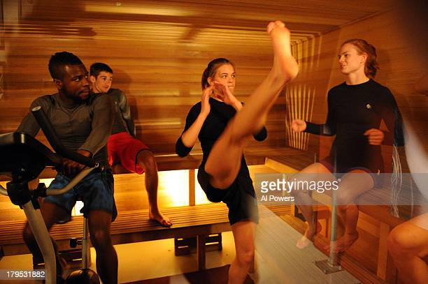 Chris Beal Jessamyn Duke and Peggy Morgan interact in the sauna during filming of season eighteen of The Ultimate Fighter on May 30 2013 in Las Vegas...