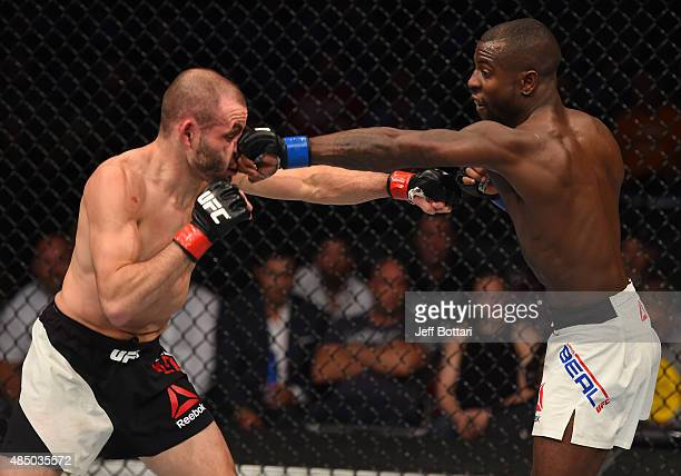 Chris Beal of the United States punches Chris Kelades in their flyweight bout during the UFC event at the SaskTel Centre on August 23 2015 in...