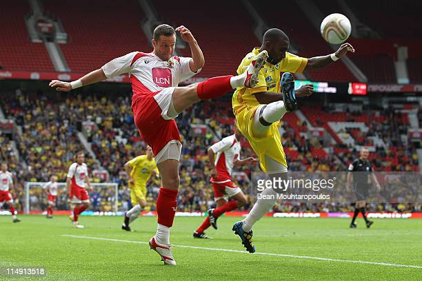 Chris Beardsley of Stevenage gets the ball past Lathaniel RoweTurner of Torquay during the npower League Two Playoff Final between Stevenage and...
