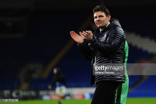 Chris Beech Head Coach of Carlisle United applauds the fans at the final whistle during the FA Cup third round match between Cardiff City and...