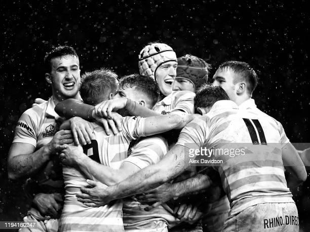 Chris Bell of Cambridge celebrates scoring his sides third try with teammates during the Oxford University vs Cambridge University Men's Varsity...