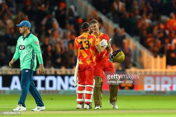 Chris Benjamin of Birmingham Phoenix celebrates victory with teammate Ben Howell during The Hundred match between Birmingham Phoenix Men and Oval...