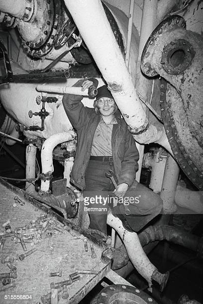 Chris Berringer of Glen Campbell Pennsylvania repairs an evaporator in the Vulcan's engine room Chris one of several gal sailors aboard the Vulcan...