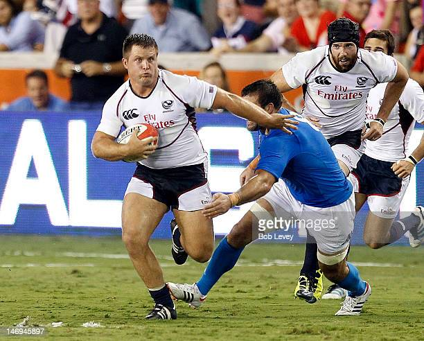 Chris Biller of the USA Eagles fends off Robert Julian Barbieri of Italy at BBVA Compass Stadium on June 23 2012 in Houston Texas