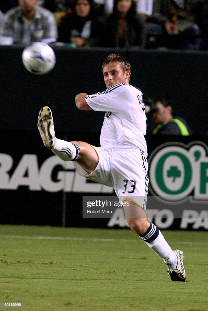 Chris Birchall #33 of the Los Angeles Galaxy attempts to stop a ball in mid air against the defense of the San Jose Earthquakes during their MLS game at The Home Depot Center on October 24, 2009 in Carson, California.