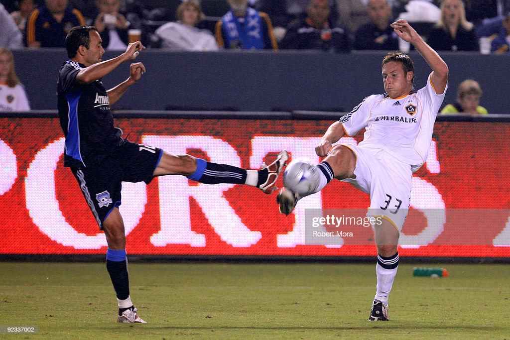Chris Birchall #33 of the Los Angeles Galaxy battles Ramiro Corrales #12 of the San Jose Earthquakes during their MLS game at The Home Depot Center for a loose ball on October 24, 2009 in Carson, California.