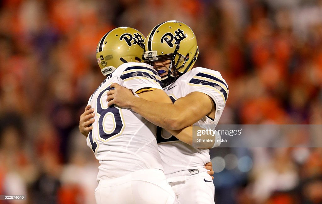 Chris Blewitt #12 celebrates with teammate Ryan Winslow #18 of the Pittsburgh Panthers after making a game winning field goal to defeat the Clemson Tigers 43-42 during their game at Memorial Stadium on November 12, 2016 in Clemson, South Carolina.