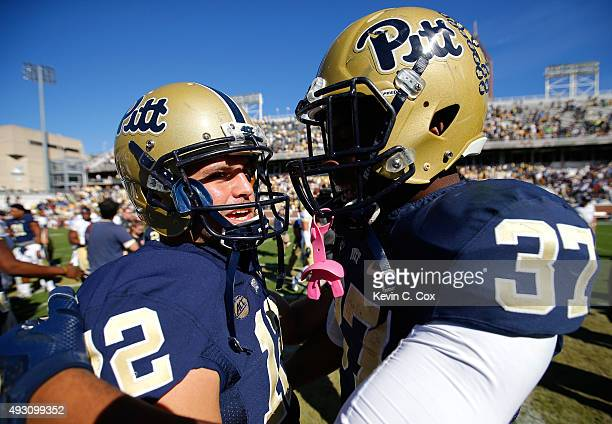 Chris Blewitt of the Pittsburgh Panthers is congratulated by Qadree Ollison after their 3128 win over the Georgia Tech Yellow Jackets at Bobby Dodd...