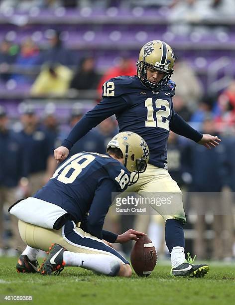 Chris Blewitt of the Pittsburgh Panthers kicks an extra point during the Lockheed Martin Armed Forces Bowl game against the Houston Cougars at Amon G...