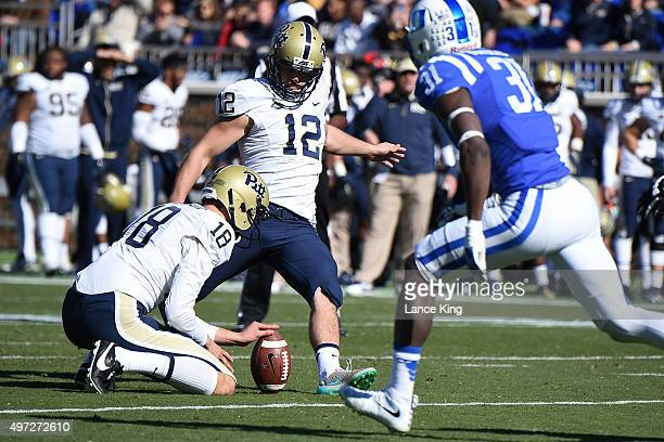 Chris Blewitt of the Pittsburgh Panthers kicks for an extra point from the hold of Ryan Winslow against the Duke Blue Devils at Wallace Wade Stadium...