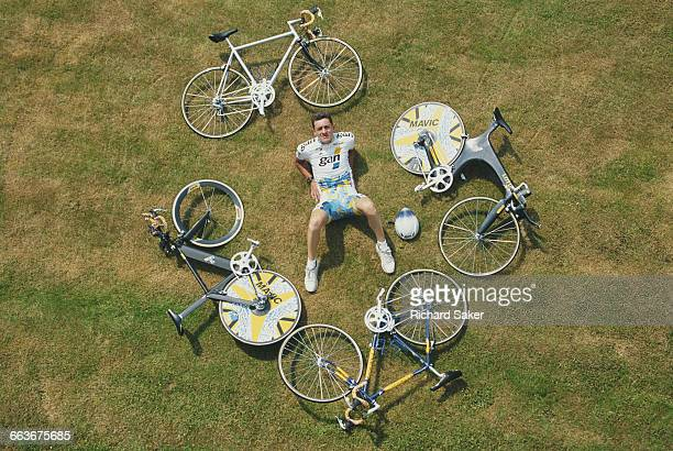 Chris Boardman of Great Britain and rider for the GAN cycling team poses for a portrait with his racing bicycles before the Individual time trial of...