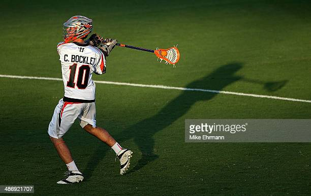 Chris Bocklet of the Denver Outlaws passes during a game against the Florida Launch at FAU Stadium on April 26 2014 in Boca Raton Florida