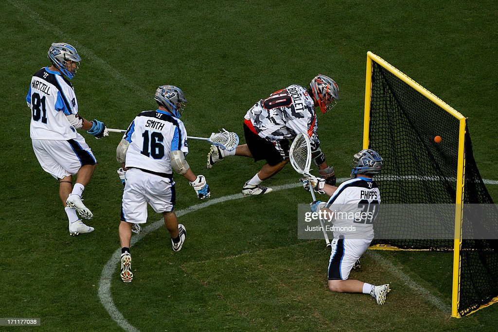 Chris Bocklet #10 of the Denver Outlaws scores a goal past goaltender Brian Phipps #30 of the Ohio Machine as Kyle Hartzell #81 and Joe Smith #16 are slow to defend during the second quarter at Sports Authority Field at Mile High on June 22, 2013 in Denver, Colorado.