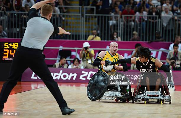 Chris Bond of Australia battles for the ball against Daisuke Ikezaki of Japan during the Mixed Wheelchair Rugby Open semifinal match between the...