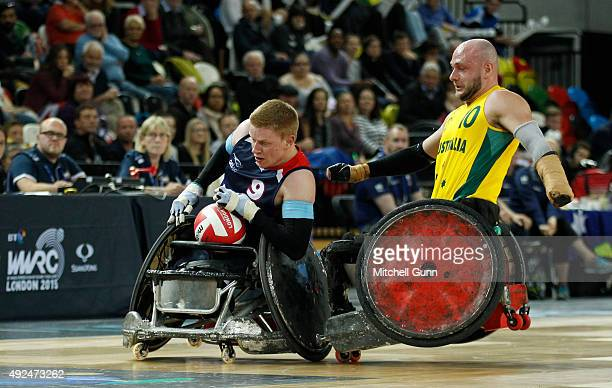 Chris Bond of Australia crashes into Jim Roberts of Great Britain during the 2015 BT World Wheelchair Rugby Challenge match between Great Britain and...