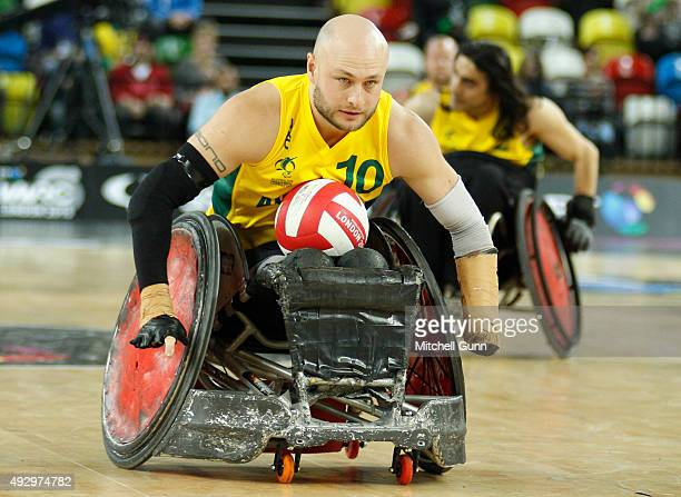 Chris Bond of Australia scores a try during the 2015 BT World Wheelchair Rugby Challenge bronze medal playoff match between Australia and Japan at...