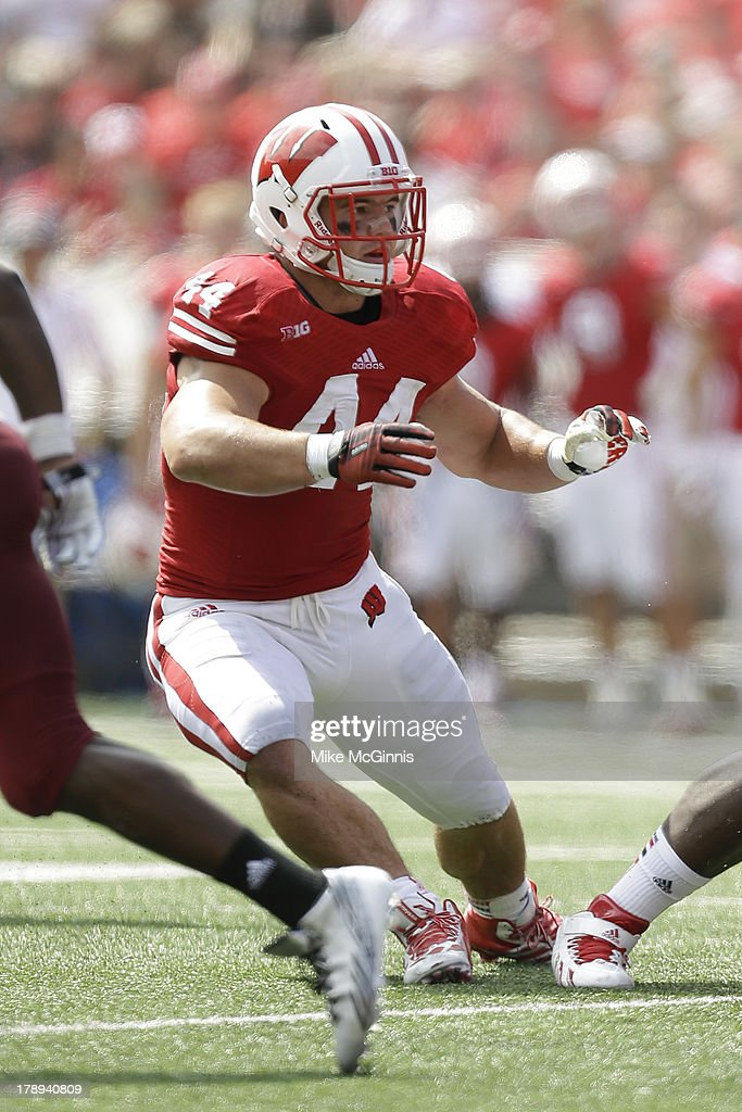 Chris Borland #44 of the Wisconsin Badgers in pursuit for the football during the game against the UMass Minutemen at Camp Randall Stadium on August 31, 2013 in Madison, Wisconsin.