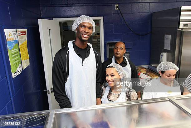 Chris Bosh and Adrienne Bosh attend the 2nd year with the Chapman Partnership to help feed the local families of Miami this Thanksgiving at Chapman...
