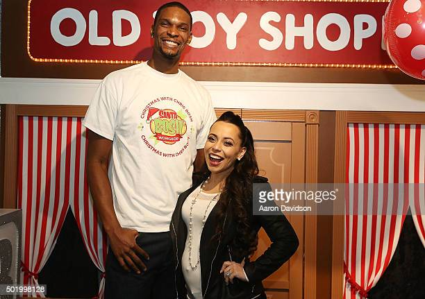 Chris Bosh and Adrienne Bosh attends Team Tomorrow Celebrates Christmas with Chris Bosh at Santa Boshs Workshop on December 19 2015 in Miami Florida