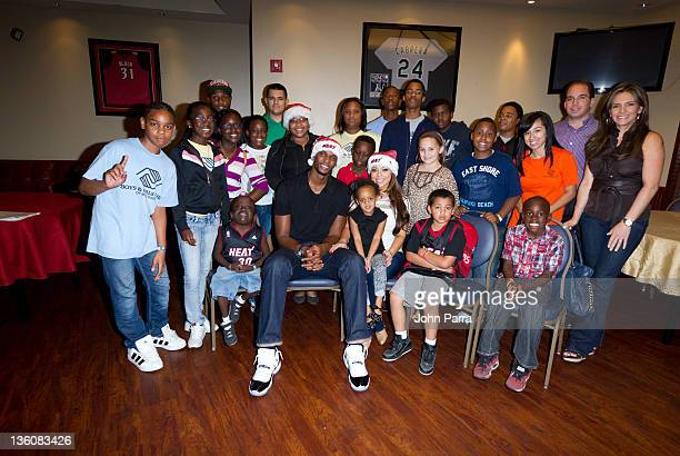 Chris Bosh and Adrienne Bosh spread Christmas joy to underprivileged youth at his 2nd annual Christmas with Chris Bosh at Game Time at Sunset Place...