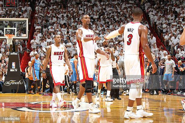 Chris Bosh and Dwyane Wade of the Miami Heat celebrate a win over the Oklahoma City Thunder in Game Three of the 2012 NBA Finals at American Airlines...