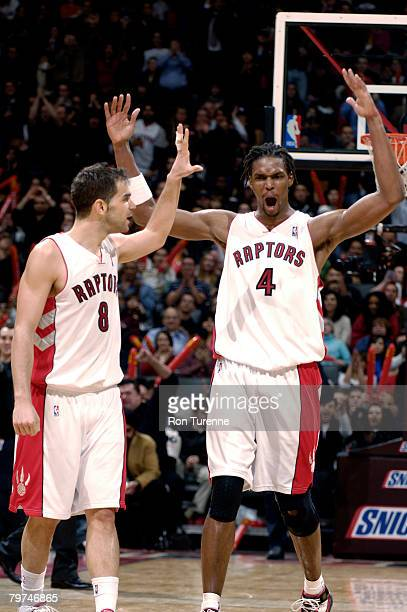 Chris Bosh and Jose Calderon of the Toronto Raptors celebrate a win against the New Jersey Nets on February 13 2008 at the Air Canada Centre in...