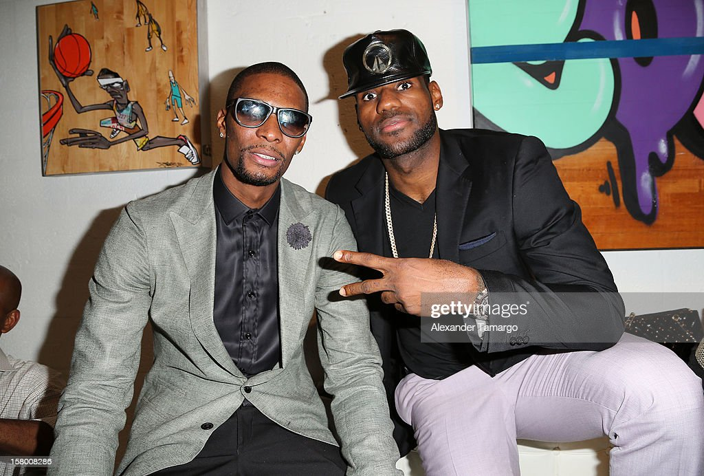Chris Bosh and LeBron James make an appearance as Premier Beverage Hosts Art Of Basketball: Heat Wave With Dwyane Wade & Chris Bosh on December 7, 2012 in Miami, Florida.