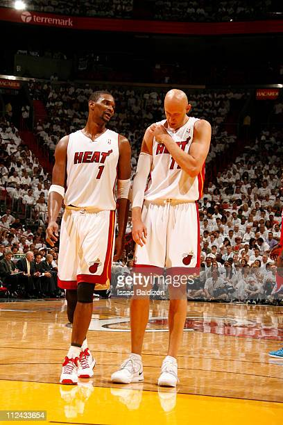 Chris Bosh and Zydrunas Ilgauskas of the Miami Heat talk against the Philadelphia 76ers in Game Two of the Eastern Conference Quarterfinals in the...