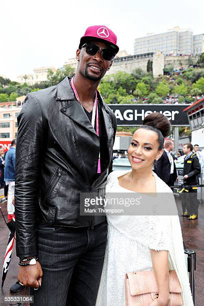Chris Bosh basketball player and his wife Adrienne Bosh in the Pitlane before the Monaco Formula One Grand Prix at Circuit de Monaco on May 29 2016...