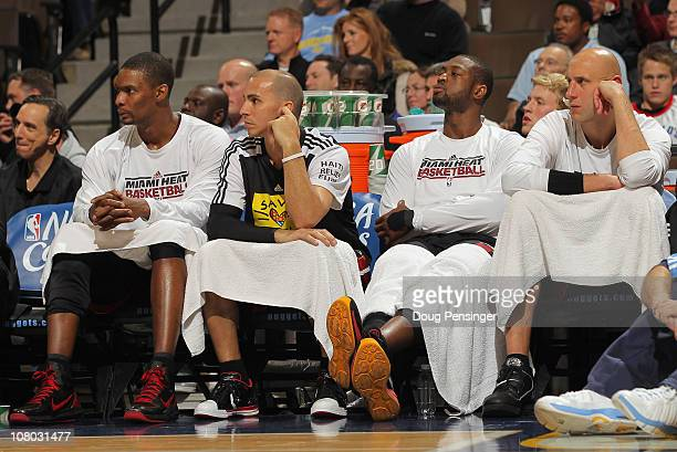 Chris Bosh Carlos Arroyo Dwyane Wade and Zydrunas Ilgaukas of the Miami Heat sit on the bench in the fourth quarter against the Denver Nuggets at the...