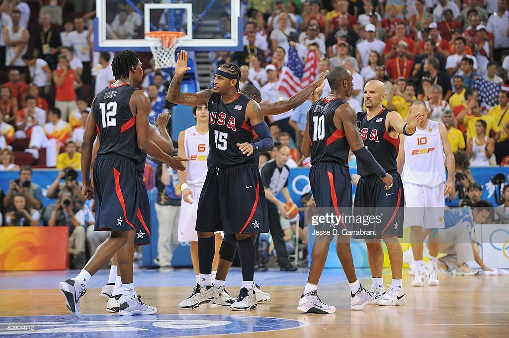 Chris Bosh #12, Carmelo Anthony #15, Dwyane Wade #9, Kobe Bryant #10, and Jason Kidd #5 of the United States celebrate on the court during the gold medal game of the 2008 Beijing Summer Olympics against Spain at the Beijing Olympic Basketball Gymnasium on August 24, 2008 in Beijing, China. The United States defeated Spain 118-107 to take the men's gold medal.