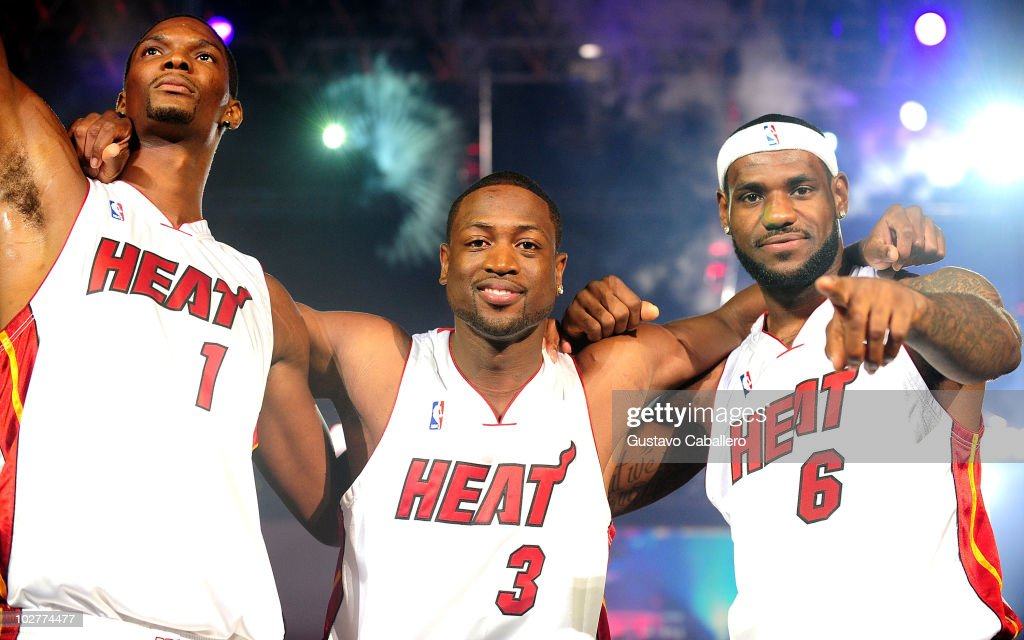 Chris Bosh #1, Dwyane Wade #3, and LeBron James #6 of the Miami Heat are introduced at the HEAT Summer of 2010 Welcome Event at AmericanAirlines Arena on July 9, 2010 in Miami, Florida.