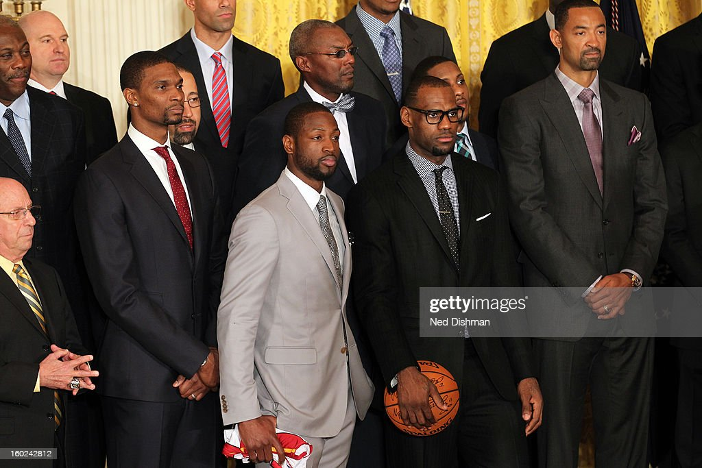Chris Bosh #4, Dwyane Wade #3 and LeBron James #6 of the Miami Heat listen during a visit by the Miami Heat to the White House to commemorate the 2012 NBA Champions on January 28, 2013 in Washington, DC.