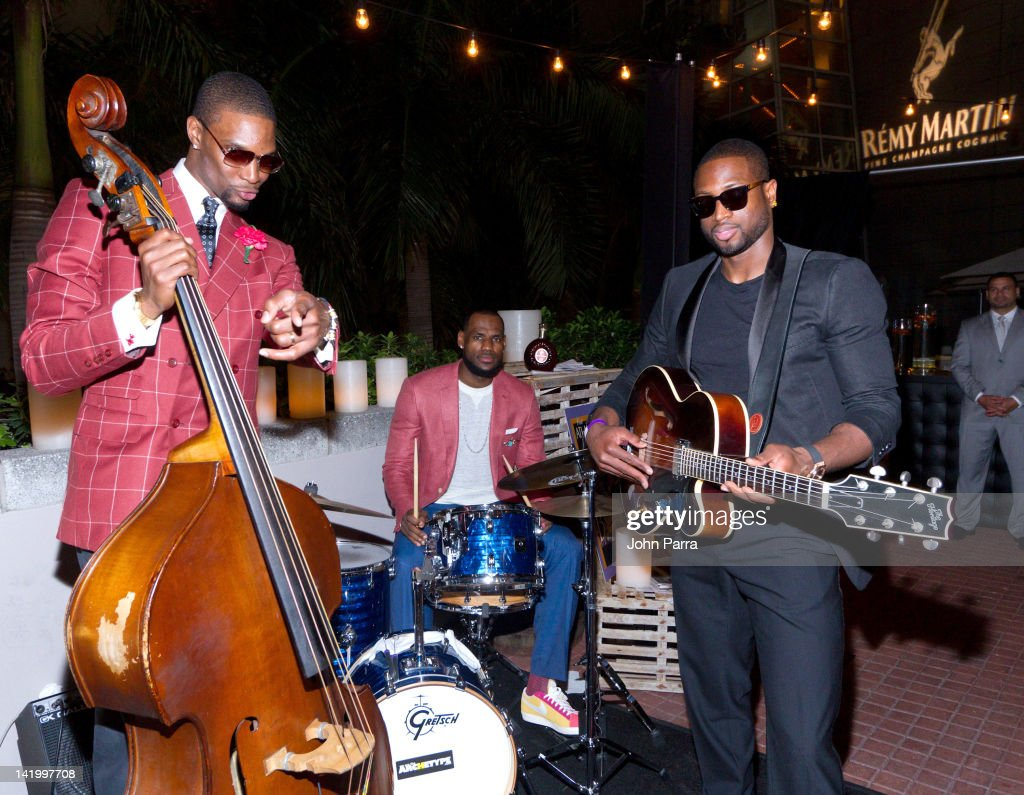 Chris Bosh, Lebron James and Dwyane Wade attend the Remy Martin presents Chris Bosh comedy club & Board walk casino night at Prelude at Barton G on March 28, 2012 in Miami, Florida.