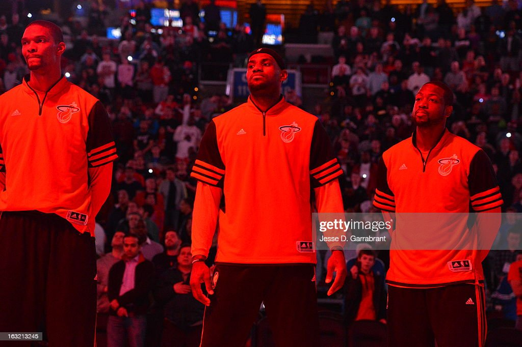 Chris Bosh #1, LeBron James #6 and Dwyane Wade #3 of the Miami Heat stand on the court before the game against the Philadelphia 76ers at the Wells Fargo Center on February 23, 2013 in Philadelphia, Pennsylvania.