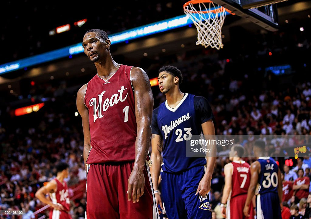 Chris Bosh #1 of the Miami Heat and Anthony Davis #23 of the New Orleans Pelicans reacts after a play during the second half of the game at American Airlines Arena on December 25, 2015 in Miami, Florida.