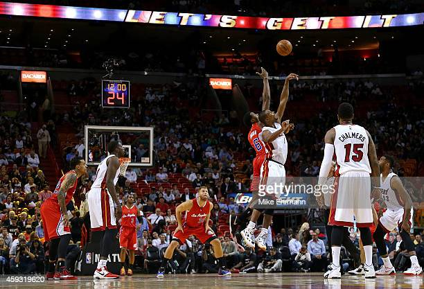 Chris Bosh of the Miami Heat and DeAndre Jordan of the Los Angeles Clippers jump ball during a game at American Airlines Arena on November 20 2014 in...