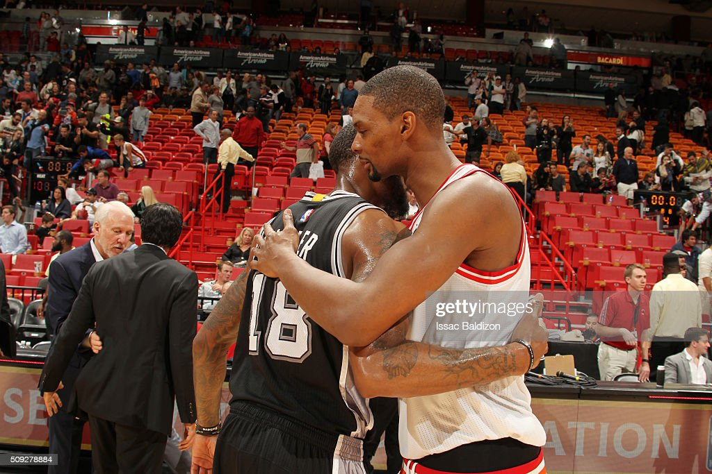 Chris Bosh #1 of the Miami Heat and Rasual Butler #18 of the San Antonio Spurs hug after the game on February 9, 2016 at American Airlines Arena in Miami, Florida.