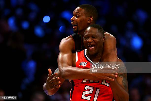 Chris Bosh of the Miami Heat and the Eastern Conference celebrates with NBA Legend Dominique Wilkins after winning the Degree Shooting Stars...