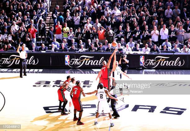 Chris Bosh of the Miami Heat and Tim Duncan of the San Antonio Spurs go after the opening jump ball to start Game Three of the 2013 NBA Finals at the...