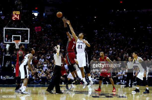 Chris Bosh of the Miami Heat and Tim Duncan of the San Antonio Spurs jump for the opening tip during Game One of the 2014 NBA Finals at the ATT...
