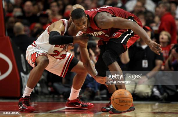 Chris Bosh of the Miami Heat battles for a loose ball with Taj Gibson of the Chicago Bulls at the United Center on January 15 2011 in Chicago...